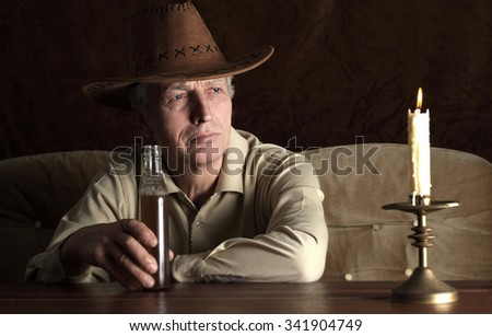Portrait of a nice mature man in cowboy hat - stock photo
