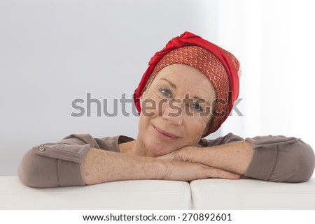 Portrait of a nice middle-aged woman recovering after chemotherapy - focus on her smiling positive attitude - stock photo
