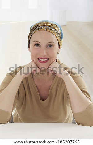 Portrait of a nice middle-aged woman recovering after chemotherapy - focus on her smiling relax attitude  - stock photo