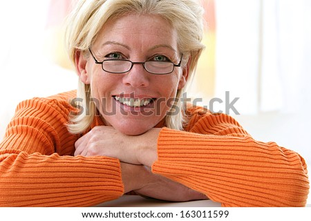Portrait of a nice middle aged woman wish glasses - stock photo