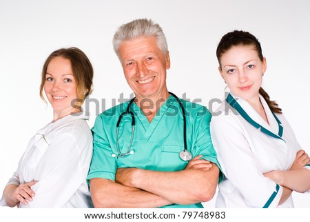 portrait of a nice three doctors on white