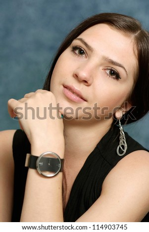 portrait of a nice woman posing on a blue - stock photo