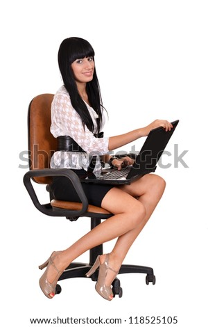 portrait of a nice woman sitting on an office chair - stock photo