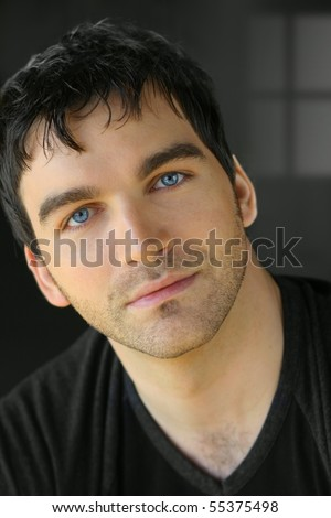 Portrait of a nice young attractive man with blue eyes - stock photo