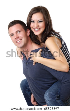 portrait of a nice young couple in studio - stock photo