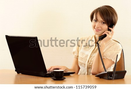 Portrait of a nice young girl with a laptop - stock photo