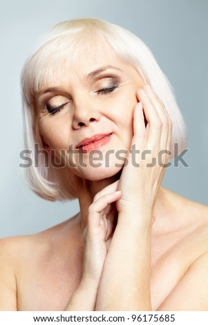 Portrait of a nude woman with her eyes closed - stock photo