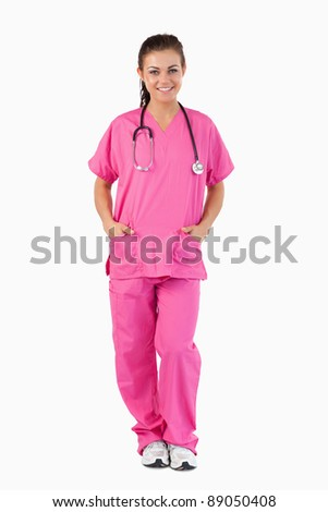 Portrait of a nurse standing up against a white background
