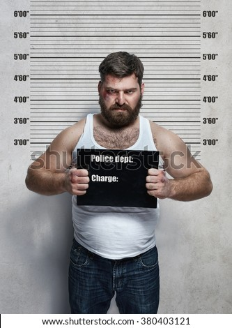 Portrait of a obese hardened criminal
