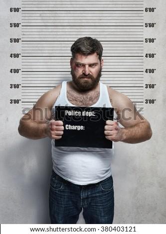 Portrait of a obese hardened criminal  - stock photo