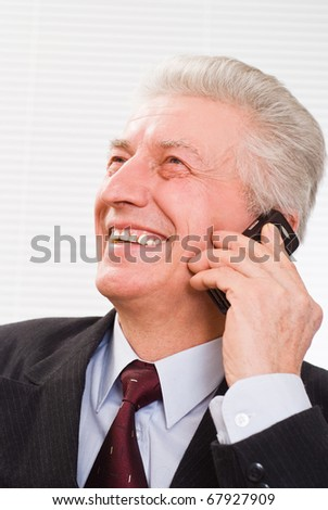 Portrait of a old business man on a white