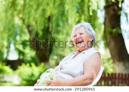 Portrait of a old woman - stock photo
