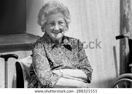 Portrait of a old woman - smiling - stock photo