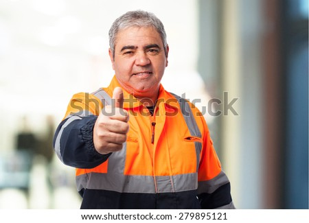 portrait of a outdoor worker doing an okay symbol - stock photo
