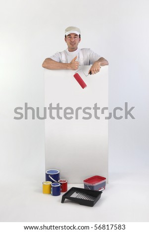 Portrait of a painter holding a panel for message on white background - stock photo