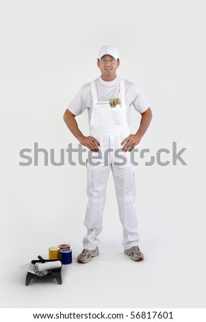 Portrait of a painter in overalls  on white background - stock photo