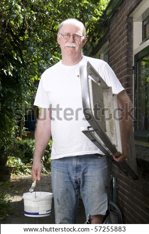 Portrait of a painter outside - stock photo