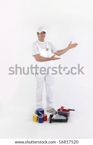 Portrait of a painter raising arms on white background - stock photo