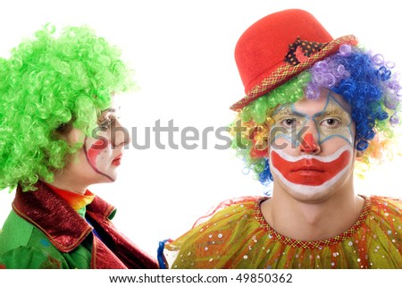 Portrait of a pair of serious clowns. Isolated