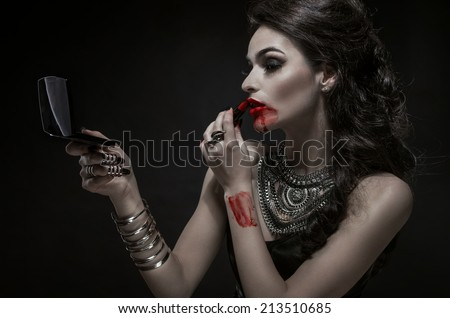 Portrait of a pale gothic vampire woman - stock photo