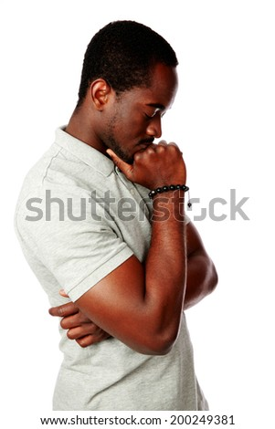 Portrait of a pensive african man over white background - stock photo