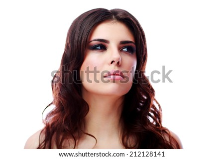 Portrait of a pensive beautiful woman over white background - stock photo