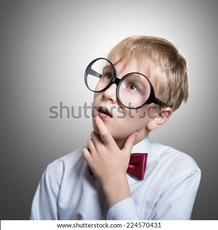 Portrait of a pensive boy in the bow tie looking up - stock photo