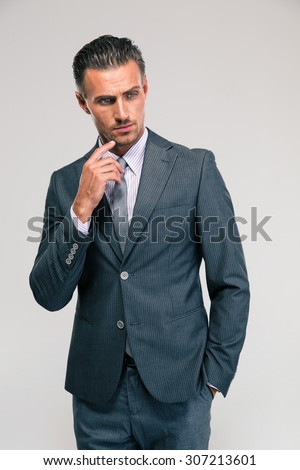 Portrait of a pensive businessman looking away isolated on a white background - stock photo