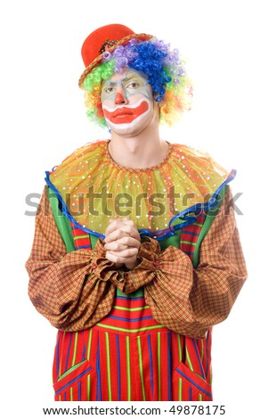 Portrait of a pensive clown. Isolated on white