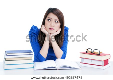 Portrait of a pensive female student with hands on chin over white background.