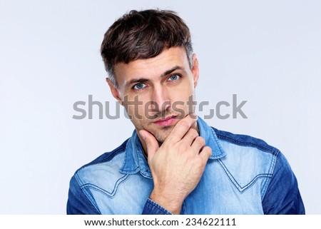 Portrait of a pensive handsome man - stock photo