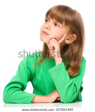 Portrait of a pensive little girl touching his cheek with index finger, isolated over white - stock photo