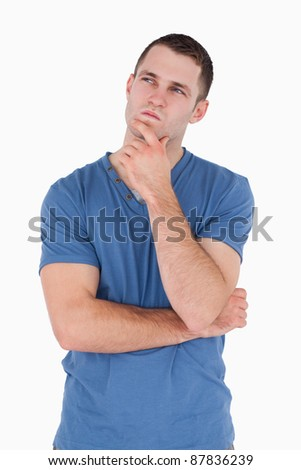 Portrait of a pensive man against a white background - stock photo