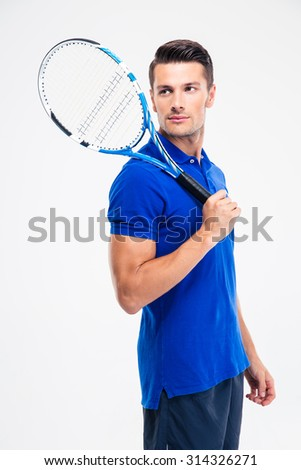 Portrait of a pensive man in sports wear and tennis racket looking away isolated on a white background - stock photo
