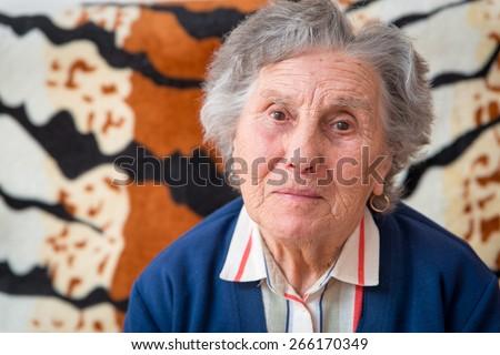 Portrait of a pensive senior woman - stock photo