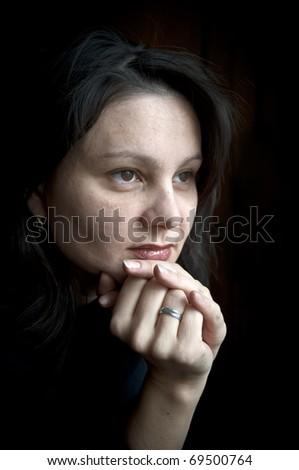 Portrait of a pensive woman - stock photo