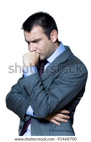 Portrait of a pensive worried businessman in studio on isolated white background - stock photo