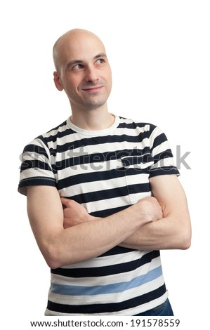 Portrait of a pensive young bald man looking up - stock photo