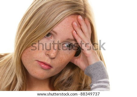 portrait of a pensive young woman. concerns and problems - stock photo