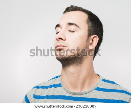 Portrait of a person with closed eyes - stock photo
