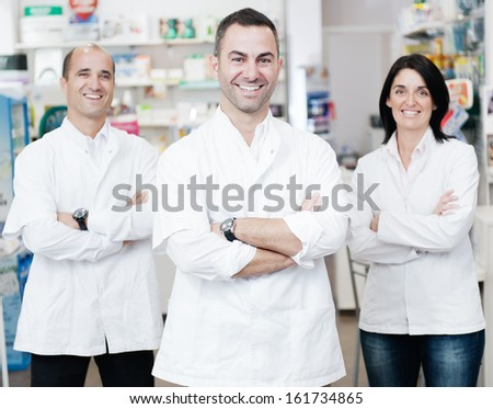 Portrait of a pharmaceutical team. They are in a real pharmacy