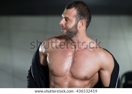 Portrait Of A Physically Fit Man Posing In Modern Fitness Center Gym