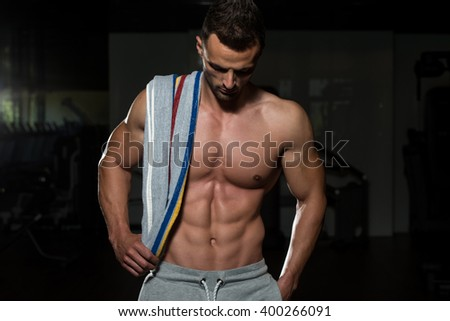 Portrait Of A Physically Fit Man Posing With Towel
