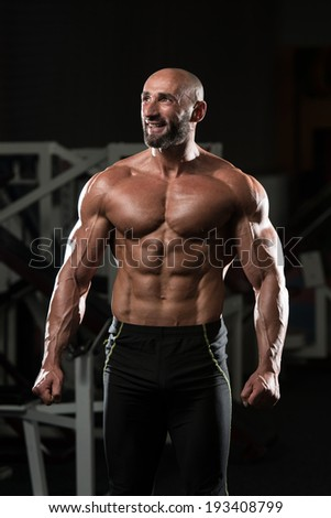 Portrait Of A Physically Fit Mature Man In A Healthy Club With Dramatic Lighting