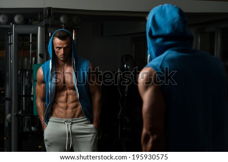 Portrait Of A Physically Fit Young Man In A Healthy Club - stock photo