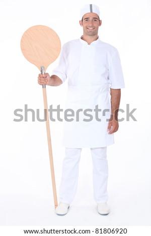 Portrait of a pizza maker - stock photo
