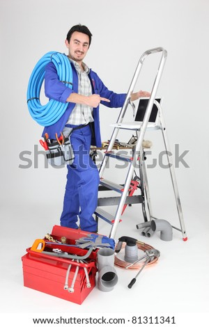 portrait of a plumber - stock photo