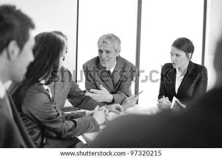 Portrait of a positive manager with his team - stock photo