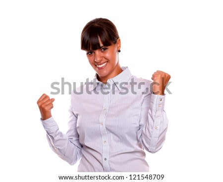 Portrait of a positive young business woman celebreting a victory on isolated background - stock photo