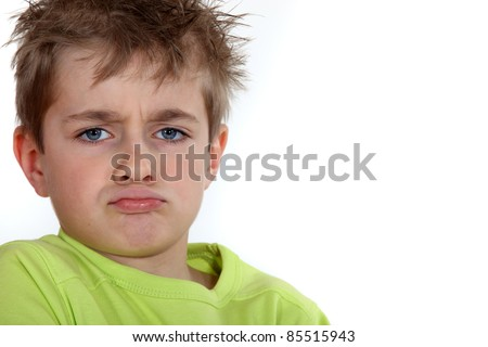 Portrait of a pouting boy - stock photo